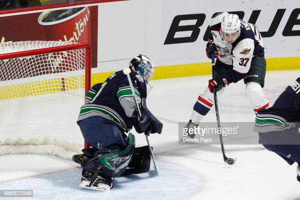 Forward Graham Knott of the Windsor Spitfires moves the puck against goaltender Rylan Toth of the Seattle Thunderbirds on May 21 2017 during Game 3...