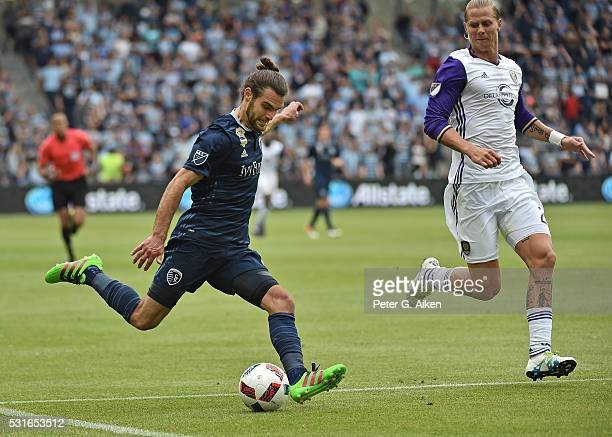 Forward Graham Zusi of Sporting Kansas City attempts a shot on goal against forward Brek Shea of Orlando City SC during the second half on May 15...