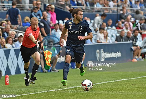 Forward Graham Zusi of Sporting Kansas City dribbles the ball up field against Orlando City SC during the second half on May 15 2016 at Children's...