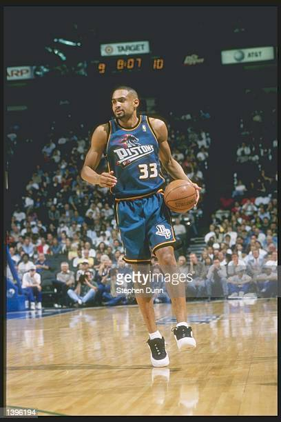 Forward Grant Hill of the Detroit Pistons dribbles the ball down the court during a game against the Dallas Mavericks at Reunion Arena in Dallas...