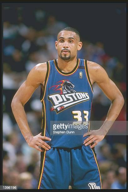 Forward Grant Hill of the Detroit Pistons stands on the court during a game against the Dallas Mavericks at Reunion Arena in Dallas Texas The Pistons...