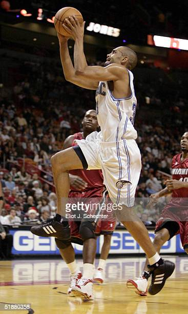 Forward Grant Hill of the Orlando Magic goes up for a shot against the Miami Heat on December 19, 2004 at the American Airlines Arena in Miami,...