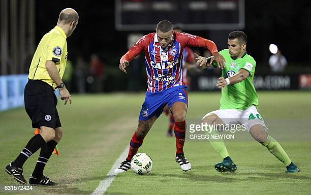 Forward Gustavo Souza of Brazilian club EC Bahia is about to be tackled by forward Robin Ziegele of German club VFL Wolfsburg during their Florida...