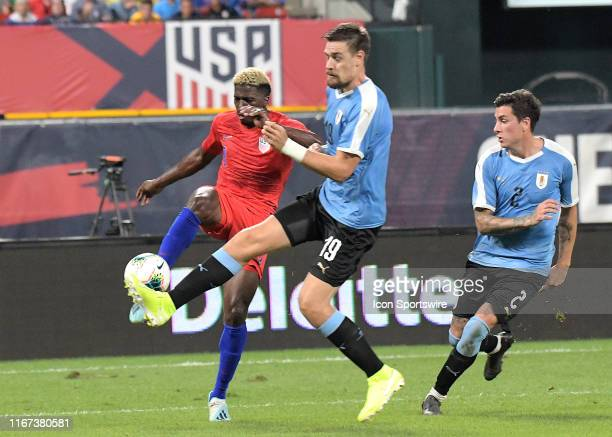 USA forward Gyasi Zardes and Uruguay defender Sebastian Coates compete for the ball during an exhibition soccer match between the US Mens National...