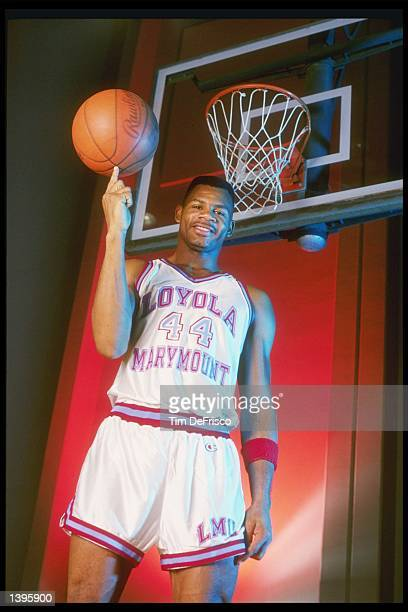 Forward Hank Gathers of the LoyolaMarymount Lions spins a basketball on his finger Mandatory Credit Tim de Frisco /Allsport