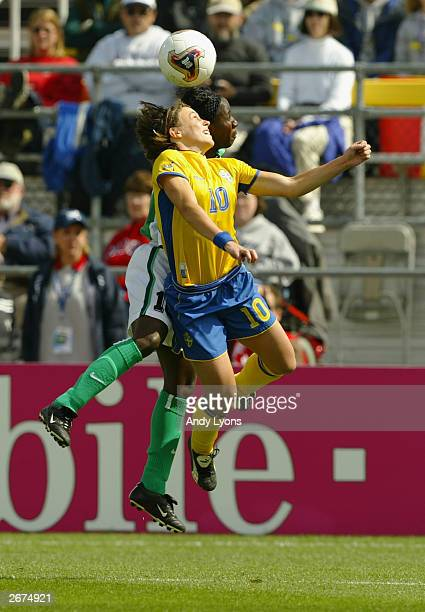 Forward Hanna Ljungberg of Sweden battles for the ball against forward Mercy Akide of Nigeria during the 2003 FIFA Women's World Cup at Crew Stadium...
