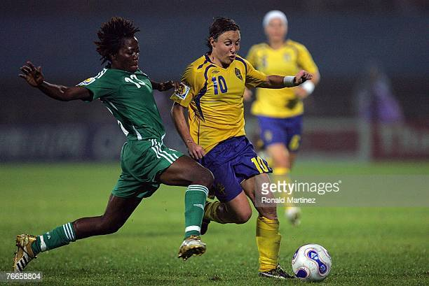 Forward Hanna Ljungberg of Sweden battles for the ball with Christie George of Nigeria during the FIFA Women's World Cup 2007 Group B match at the...