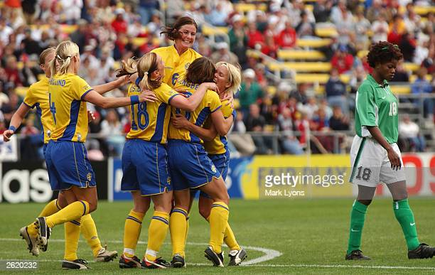 Forward Hanna Ljungberg of Sweden celebrates her first goal of the game against Nigeria as midfielder Patience Avre of Nigeria walks away during the...