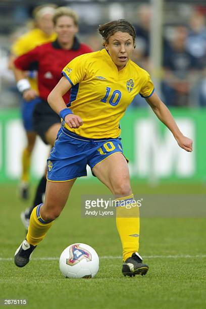 Forward Hanna Ljungberg of Sweden dribbles the ball against Nigeria during the 2003 FIFA Women's World Cup at Crew Stadium on September 28 2003 in...