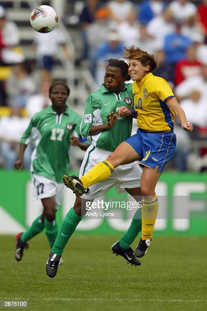 Forward Hanna Ljungberg of Sweden heads the ball over defender Onome Ebi of Nigeria during the 2003 FIFA Women's World Cup at Crew Stadium on...