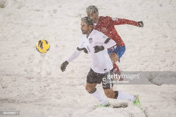 Forward Herculez Gomez of the United States tracks the ball during a FIFA 2014 World Cup Qualifier match between Costa Rica and United States at...