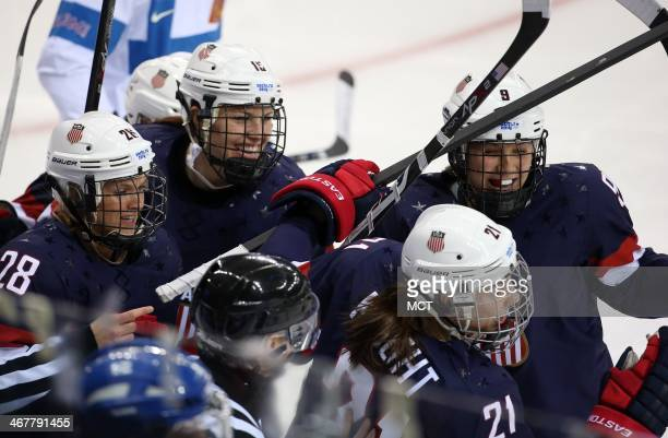 US forward Hilary Knight celebrates her goal against Finland during the first period in a women's hockey game at the Winter Olympics in Sochi Russia...