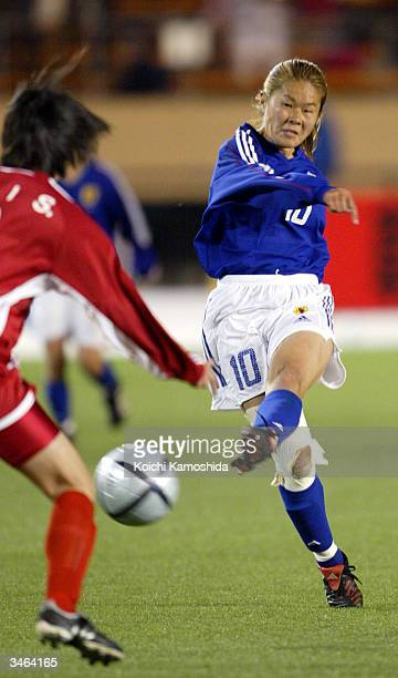 Forward Homare Sawa of the Japanese national women's soccer team kicks the ball at the AFC Olympics qualifying tournament semifinal game against...