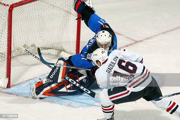 Forward Igor Radulov of the Norfolk Admirals shoots wide against goalie Wade Dubielewicz of the Bridgeport Sound Tigers at Arena at Harbor Yard on...