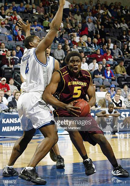 Forward Ike Diogu of the Arizona State Sun Devils moves the ball past Chris Massie of the Memphis Tiger during the first round of the NCAA Tournament...