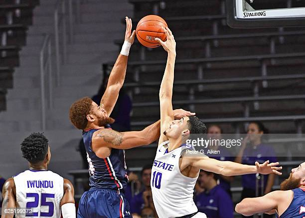 Forward Isaiah Maurice of the Kansas State Wildcats blocks the shot of forward Aaron Tate of the Robert Morris Colonials during the second half on...