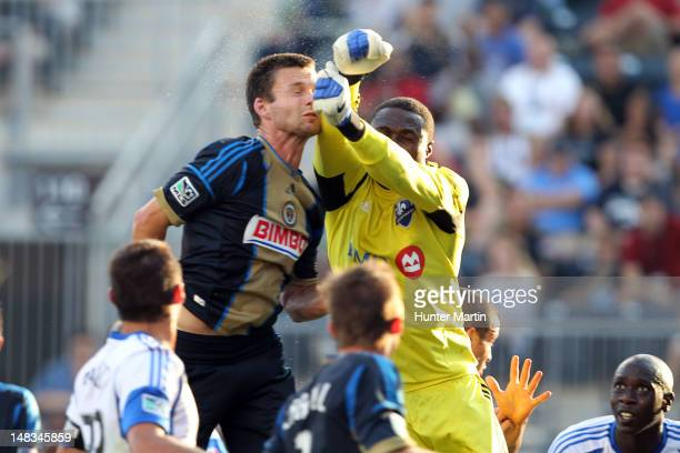 Forward Jack McInerney of the Philadelphia Union collides with goalkeeper Donovan Ricketts of the Montreal Impact during a game at PPL Park on July...