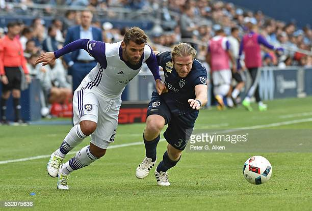 Forward Jacob Peterson of Sporting Kansas City battles for the ball with midfielder Antonio Nocerino of Orlando City SC during the second half on May...