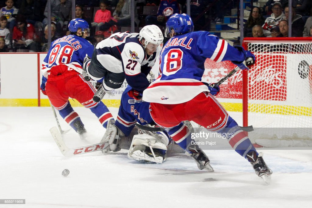 Forward Jake Smith #27 of the Windsor Spitfires battles for the puck against the Kitchener Rangers on September 28, 2017 at the WFCU Centre in Windsor, Ontario, Canada.