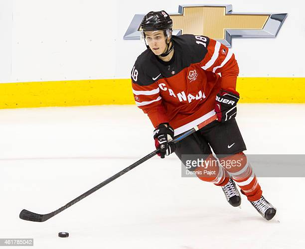 Forward Jake Virtanen of Canada moves the puck against Russia during the Gold medal game of the 2015 IIHF World Junior Championship on January 05...