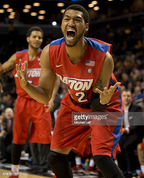 Forward Jalen Robinson of the Dayton Flyers reacts after letting the ball go out of bounds in the game against the Saint Joseph's Hawks in the...