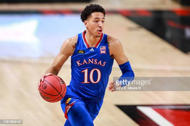 Forward Jalen Wilson of the Kansas Jayhawks handles the ball during the first half of the college basketball game against the Texas Tech Red Raiders...