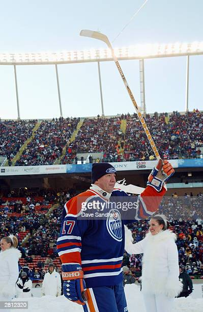 Forward Jari Kurri of the Edmonton Oilers acknowledges the fans as he skates into the rink to take on the Montreal Canadiens during the Molson...