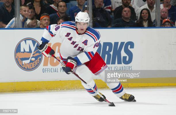 Forward Jaromir Jagr of the New York Rangers controls the puck against the New York Islanders during NHL preseason game on September 29, 2006 at the...