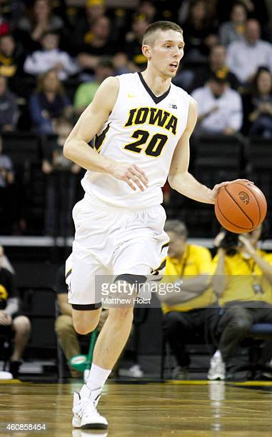 Forward Jarrod Uthoff of the Iowa Hawkeyes brings the ball down the court in the first half against the North Florida Ospreys at CarverHawkeye Arena...
