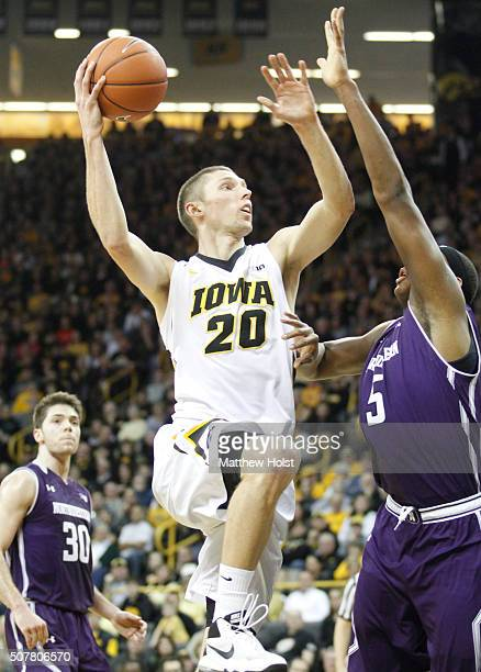 Forward Jarrod Uthoff of the Iowa Hawkeyes goes to the basket against center Dererk Pardon of the Northwestern Wildcats in the first half on January...