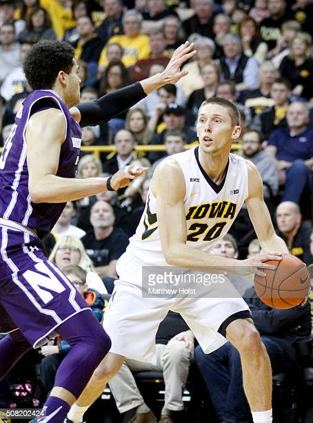 Forward Jarrod Uthoff of the Iowa Hawkeyes squares off against forward Aaron Falzon of the Northwestern Wildcats in the first half on January 31 2016...