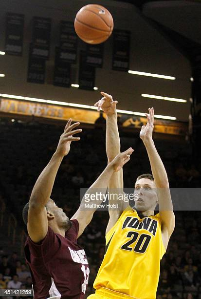 Forward Jarrod Uthoff of the Iowa Hawkeyes takes a shot during the second half in front of forward Shane Randall of the MarylandEastern Shore Hawks...