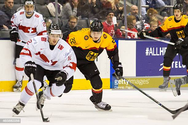 Forward Jason Fuchs of Switzerland moves the puck against Germany during the 2015 IIHF World Junior Championship on January 03 2015 at the Air Canada...