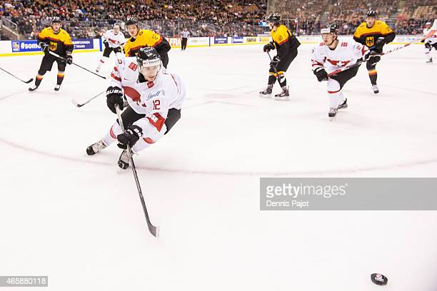 Forward Jason Fuchs of Switzerland skates against Germany during the 2015 IIHF World Junior Championship on January 03 2015 at the Air Canada Centre...