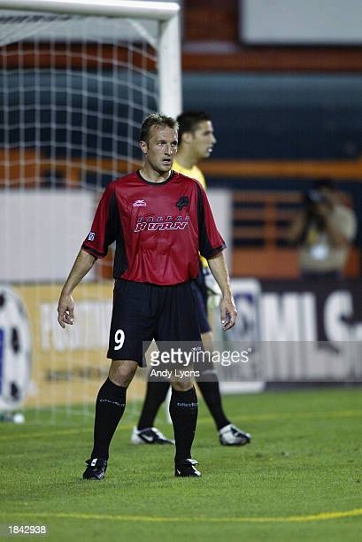 Forward Jason Kreis of the Dallas Burn looks on against the New York/New Jersey MetroStars during the MLS game on March 5 2003 at the Orange Bowl in...
