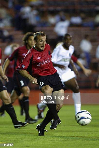 Forward Jason Kreis of the Dallas Burn passes against the New York/New Jersey MetroStars during the MLS game on March 5 2003 at the Orange Bowl in...