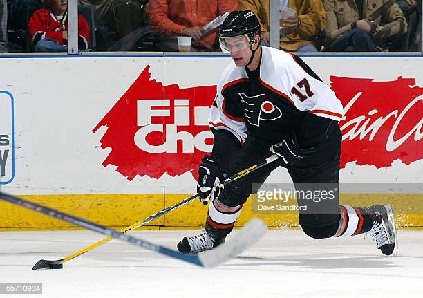Forward Jeff Carter of the Philadelphia Flyers moves the puck against the Atlanta Thrashers during their preseason game at the John Labatt Centre...