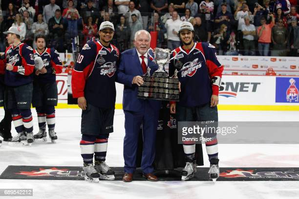 Forward Jeremiah Addison and defenceman Jalen Chatfield of the Windsor Spitfires celebrate winning the championship game of the Mastercard Memorial...