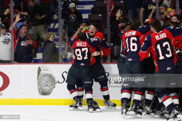 Forward Jeremy Bracco and defenceman Mikhail Sergachev of the Windsor Spitfires celebrate winning the championship game of the Mastercard Memorial...
