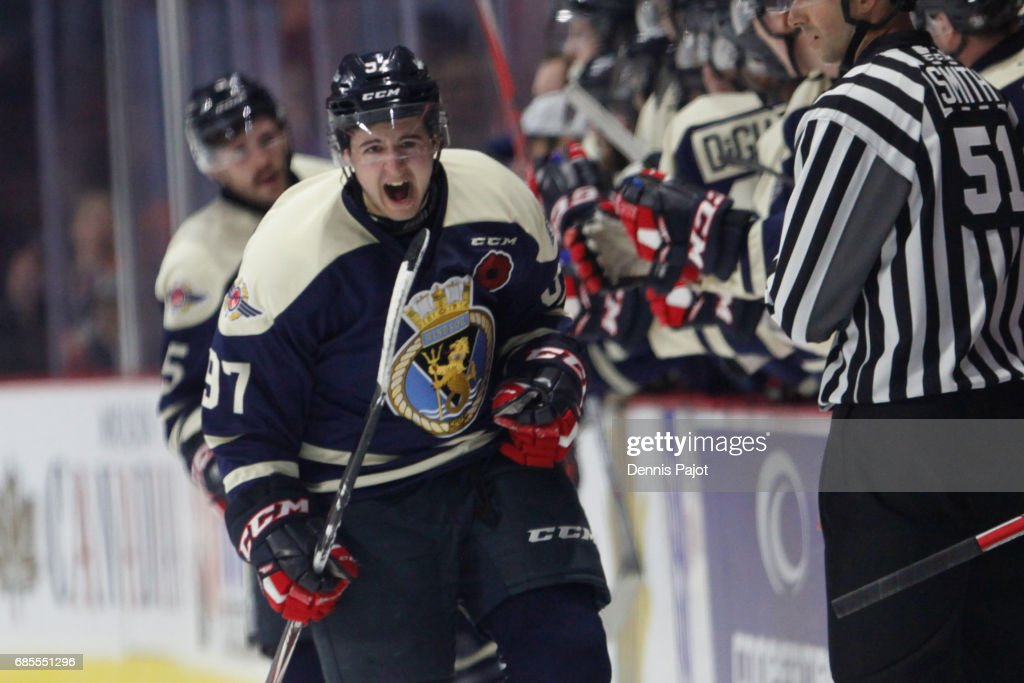 Forward Jeremy Bracco #97 of the Windsor Spitfires celebrates his second period goal against the Saint John Sea Dogs on May 19, 2017 during Game 1 of the Mastercard Memorial Cup at the WFCU Centre in Windsor, Ontario, Canada.