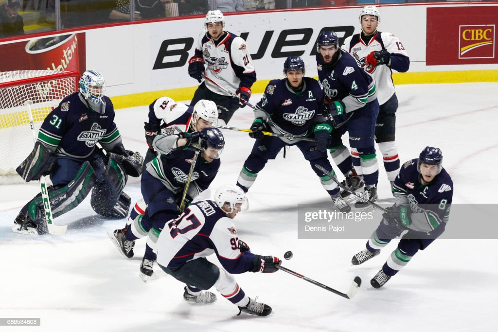 Forward Jeremy Bracco #97 of the Windsor Spitfires moves the puck against forward Scott Eansor #8 of the Seattle Thunderbirds on May 21, 2017 during Game 3 of the Mastercard Memorial Cup at the WFCU Centre in Windsor, Ontario, Canada.