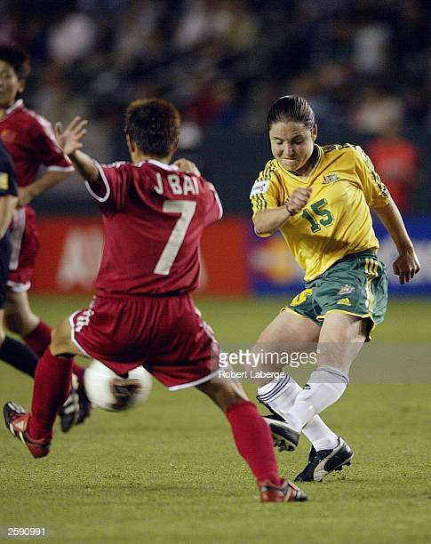 Forward Jie Bai of China attempts to stop a kick by midfielder Tal Karp of Australia during the first round of the FIFA Women''s World Cup on...