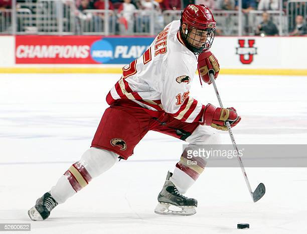 Forward Jon Foster of the Denver Pioneers moves the puck against the Colorado College Tigers on April 7, 2005 during the NCAA Frozen Four at Value...