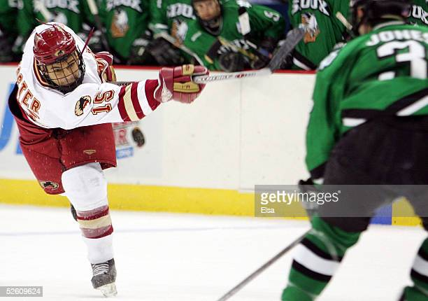 Forward Jon Foster of the Denver Pioneers shoots the puck against the North Dakota Fighting Sioux during the NCAA Frozen Four Championship game on...