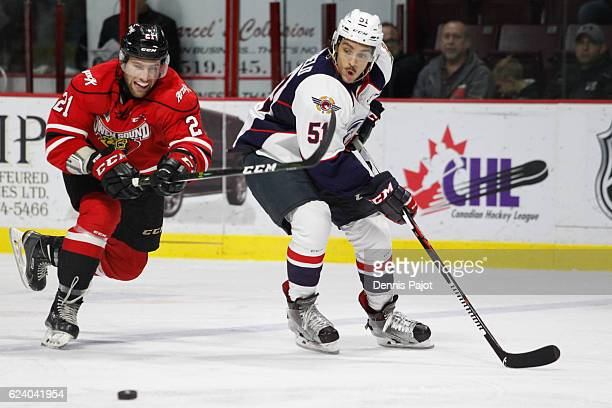 Forward Jonah Gadjovich of the Owen Sound Attack skates against defenceman Jalen Chatfield of the Windsor Spitfires on November 17 2016 at the WFCU...
