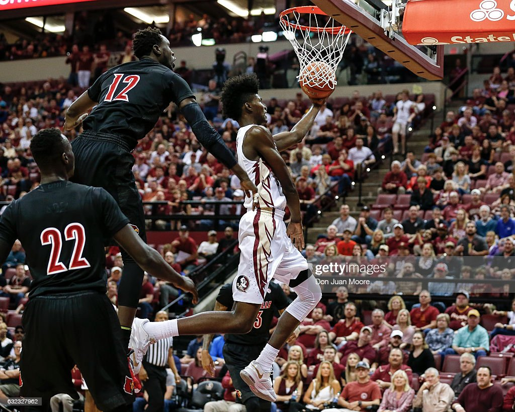 Forward Jonathan Isaac #1 of the Florida State Seminoles drives to the basket against Forwards Adel Deng #22 and Mangok Mathiang #12 of the Louisville Cardinals at the Donald L. Tucker Center on January 21, 2017 in Tallahassee, Florida. The 10th ranked Seminoles defeated the 12th ranked Cardinals 73 to 68.