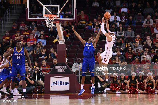 USC forward Jordan Usher shoots a fadeaway jump shot over UCSB forward Jalen Canty during a college basketball game between the UC Santa Barbara...