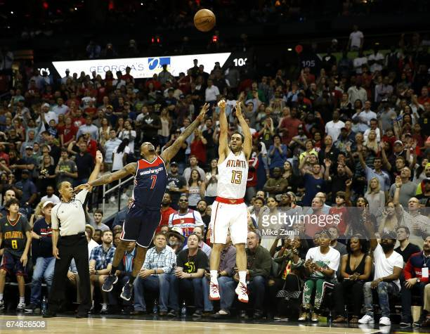 Forward Jose Calderon of the Atlanta Hawks shoots over guard Brandon Jennings of the Washington Wizards during Game Six of the Eastern Conference...