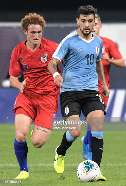 USA forward Josh Sargent competed for the ball with Uruguay midfielder Giorgian De Arrascaeta during an exhibition soccer match between the US Mens...