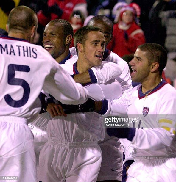 US forward Josh Wolff is congratulated by teammates Clint Mathis Regis David and Chris Armas after Wolff scored the first US goal of the game at the...